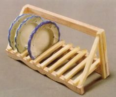 DIY Dishrack-- This looks like it was made with toothpicks. Instructions are in Spanish (Google Translate saves the day again!) This would work great as doll house or Barbie furniture. Bottle caps painted with nail polish would work for plates as well.