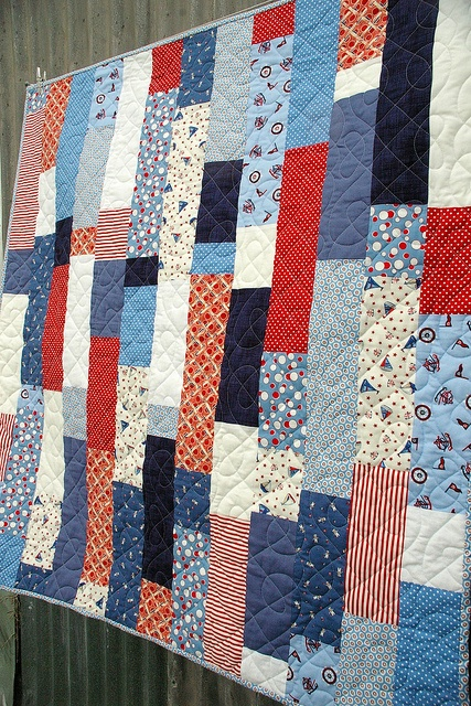 red and blue and white quilt. is it too specific to have a 4th of july parade watching quilt? I think not. The people sitting next to us this year had one and it was precious!