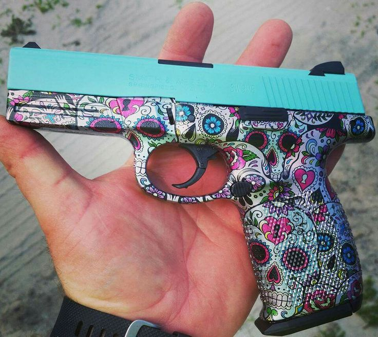 Gorgeous!! I'll take two!! Smith & Wesson in sugar skulls and robins egg blue cerakote.