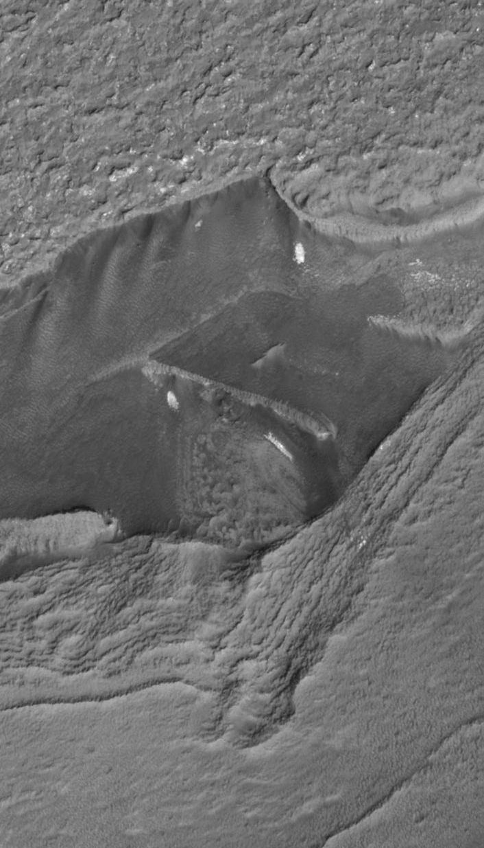 What is this? This image of the surface of Mars was taken by the MRO Hirise image camera, at a distance of 319 kilometers away. Many are calling this photo undeniable proof of ancient civilization on Mars. This object looks like a wall, but understand that it is hundreds of meters thick, and that would make it more like a building.: