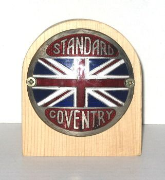 Standard Car Badge - 1927 Standard 9 Tourer.  This same badge is fitted to several Standard cars from 1915 onwards. Three colour enamel on plated brass backing.  This one has had the enamel 'repaired' in a couple of places.