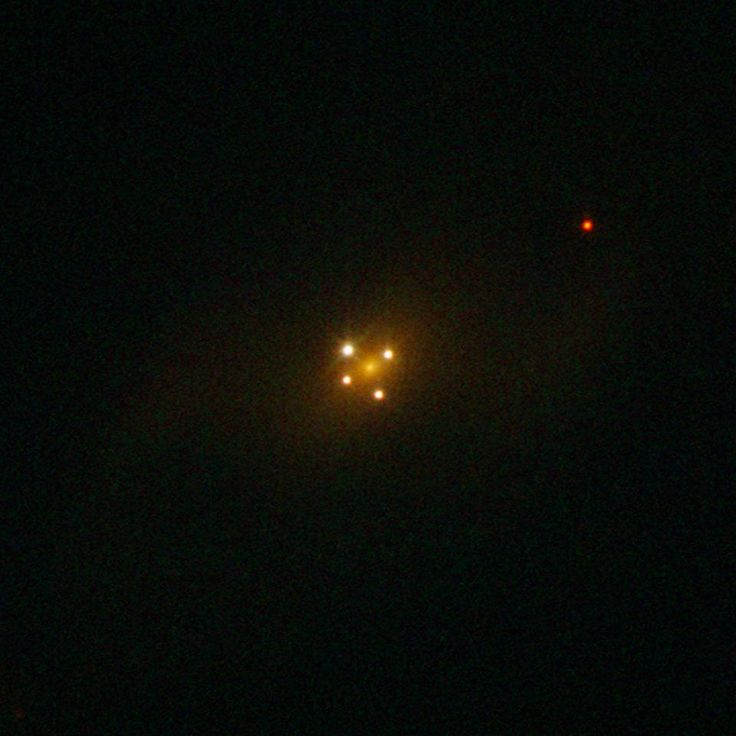 known as UZC J224030.2+032131 — has not one but five different nuclei. In fact, the core of the galaxy is only the faint and diffuse object seen at the centre of the cross-like structure formed by the other four dots, which are images of a distant q...See More