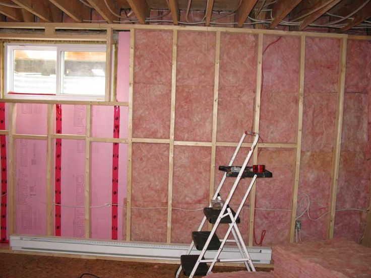 Properly insulate basement walls with extruded polystyrene and fiberglass