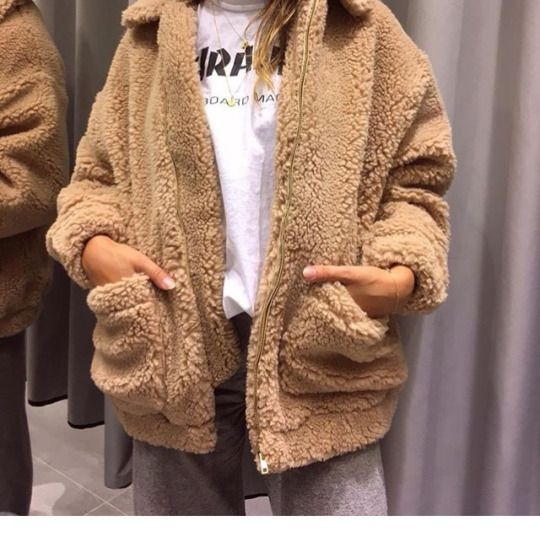 Cozy fall outfit idea, beige fuzzy coat with grey sweats and printed white tee. Easy to put together outfit.