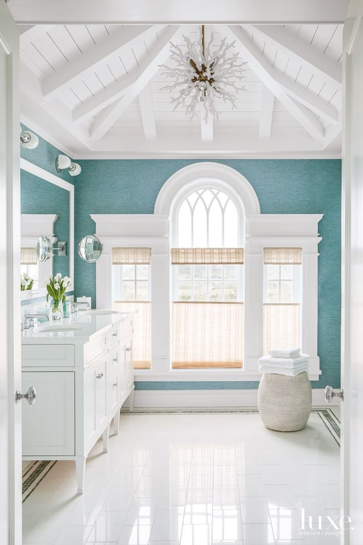 Gorgeous beachy bathroom. I love the details on the ceiling and the color of the wall.