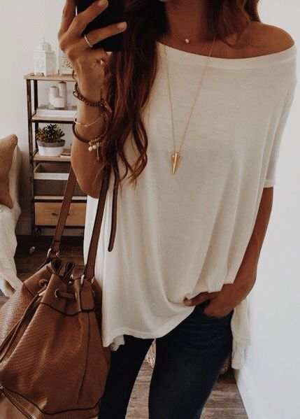 Off the shoulder white top with skinny jeans and bucket purse. The necklace is a great accessory to give this casual outfit a little something extra.