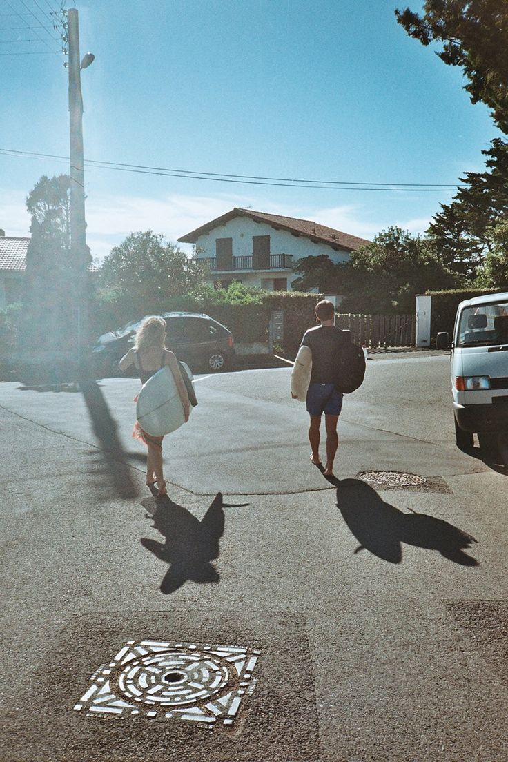 KATE & CLOVIS DONIZETTI CETUS BIARRITZ AMBASSADEUR going surfing / hot weather / shadow / surfboards / city / ready to surf in cetus yamamoto neoprene / biarritz