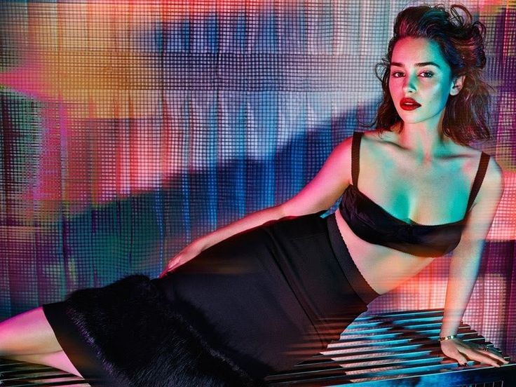 'Game of Thrones' star Emilia Clarke graces the October 2015 cover of GQ UK, wearing a slicked back hairstyle with a red pout and shimmering eyeshadow. The brunette stunner was named the magazine's annual Woman of the Year. Photographed by Hunter & Gatti, Emilia stuns while wearing looks from the likes of Balmain and Dior... [Read More]