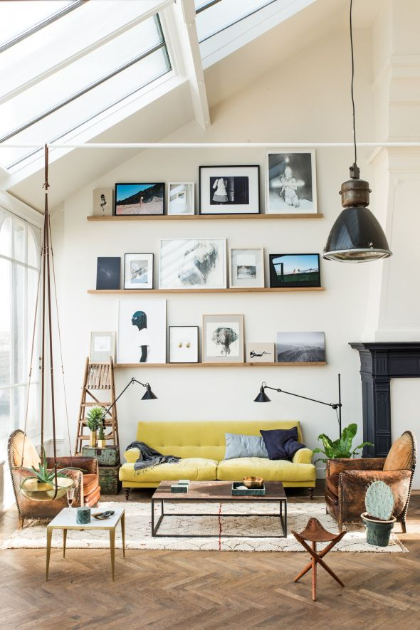 Amsterdam loft with herringbone floors, loads of natural light, and chartreuse seating.