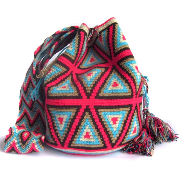 $90.00 CHOCOBERRY MOCHILA. About Wayuu Mochilas: These crochet Wayuu bags are made by Wayuu women and designed by Lombia & Co. The colors of the mochilas Wayuu are inspired by the vivid colors that surround region of La Guajira. Sand, sea, desert, sun and a clear sky are constants in the landscape. Geometric figures are a signature of these mochila bags.
