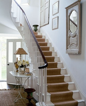 Painted white stairs with runner.