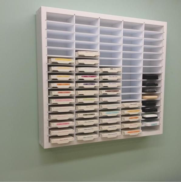"The Pro Ink Pad Organizer holds up to 80 of the most popular ink pads including, Stampin' Up, Close To My Heart, Versamark and more! Shelves are a full 3.5"" dee"