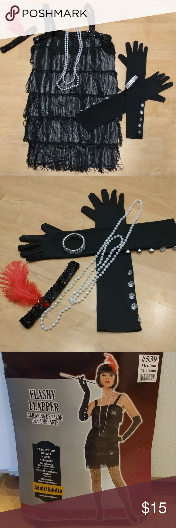 Flashy Flapper Girl Costume Worn only once!! Costume comes with dress, headpieces, gloves, bead necklace and rhinestone bracelet. Size medium. See pictures for costume measurements. Other
