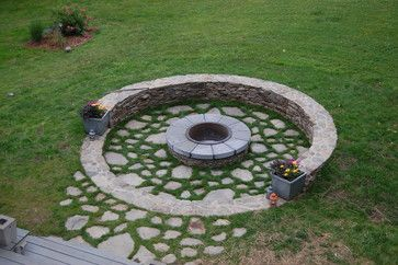 Connecticut Fire Pit - eclectic - landscape - new york - Coger Residential. I think I'd make the gaps between the flagstone smaller and use something more rustic for the fire pit cap, but I like the overall idea.