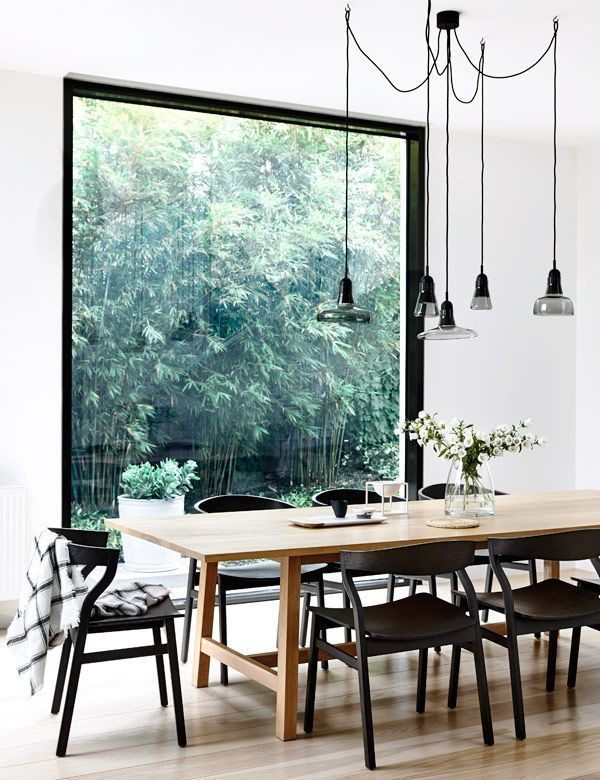 Black Chairs In Dining Room Table Decor Arrangement In 2020 Scandinavian Dining Room Dining Room Design Minimalist Dining Room