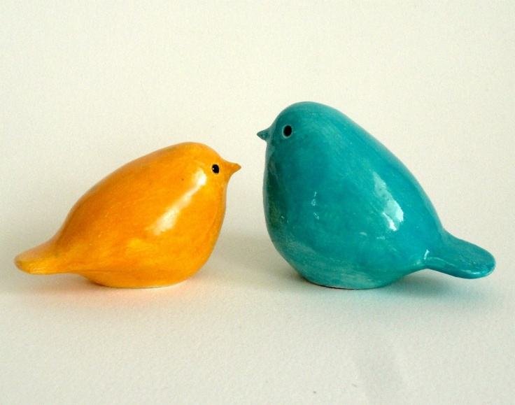 pottery birds orange and turquoise. $45.00, via Etsy.