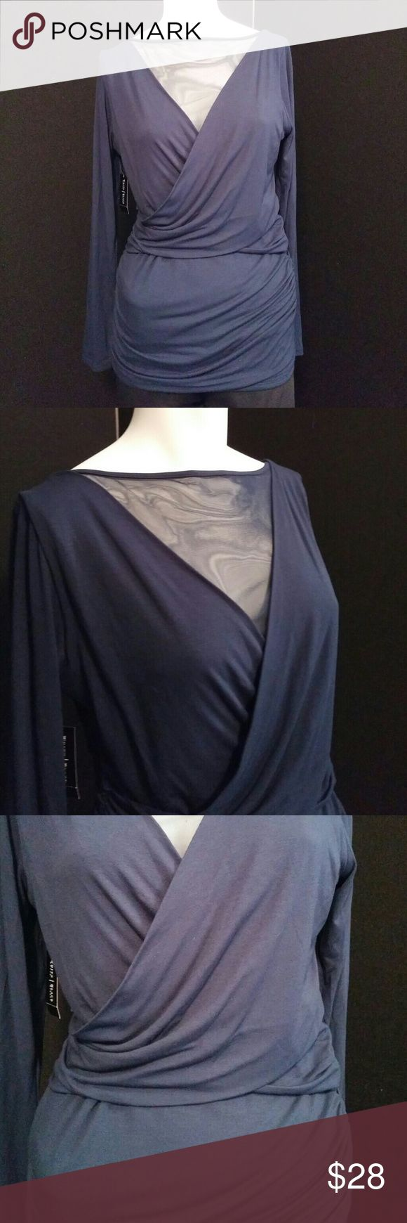 NWT White House Black Market Navy top This gorgeous White House Black Market top has a shear neck area and back area. The fabric is so comfortable stretchy and so flattering. Navy blue and color, size medium. Longer fit. New with tags. White House Black Market Tops