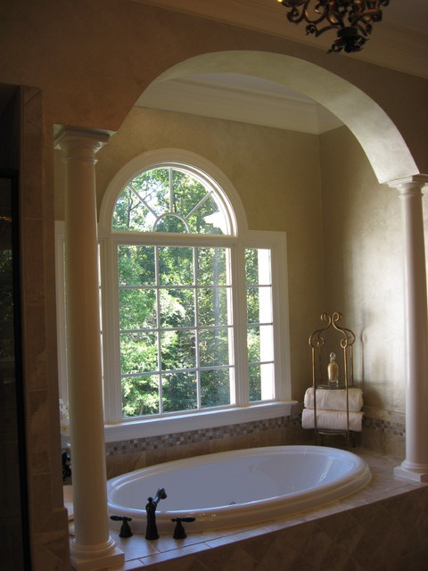 Archway In Front Of Arched Window Over Tub Home Decor