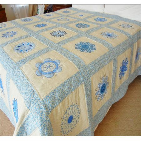 Funky-Flowers bed quilt - appliqued flower patterns on cream background