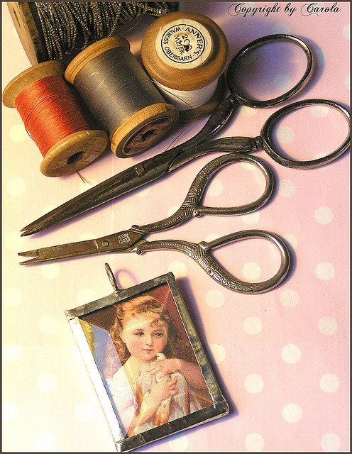 Old sewing scissors & thread and a sweet girl with dove charm