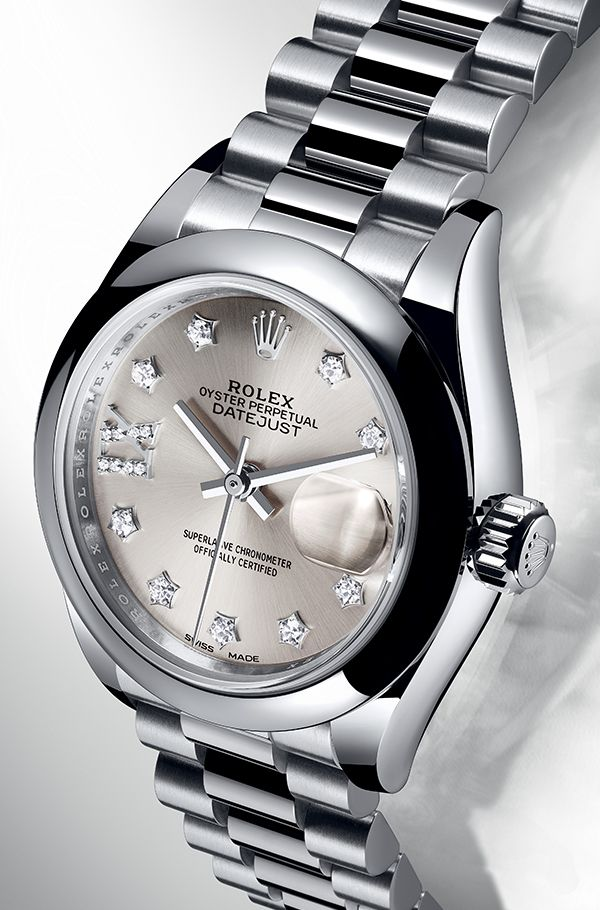The lady-Datejust 28 in platinum with a domed bezel and a silver dial set with diamonds.