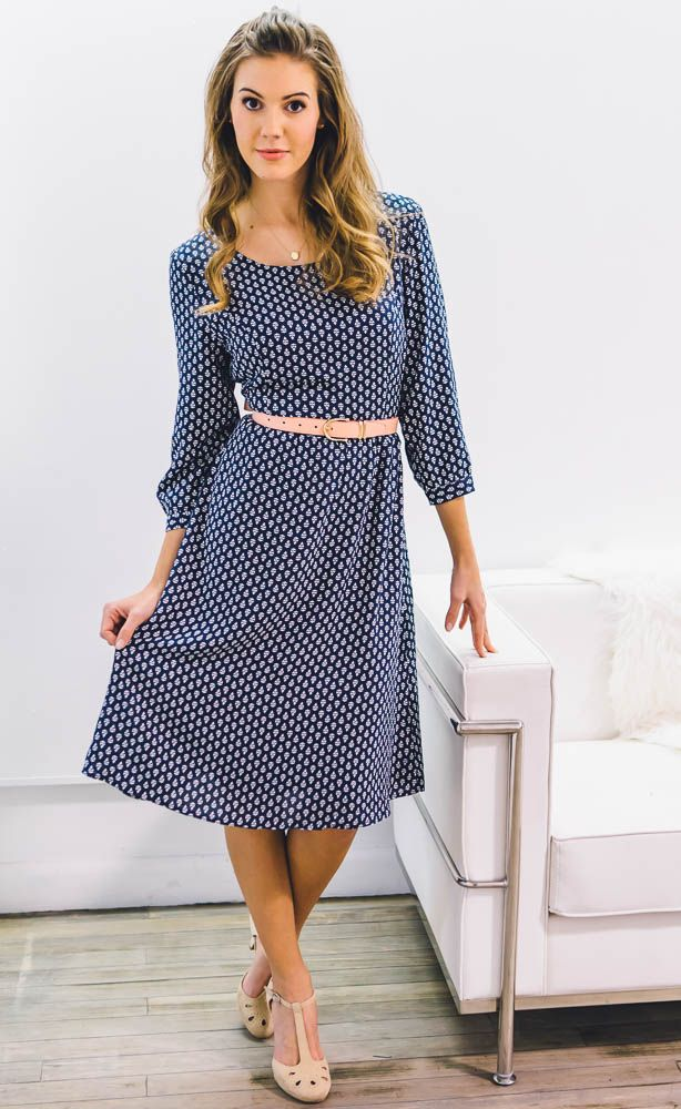 "A simple and stylish dress with fun leaf print is perfect for summer and transitioning into fall. Availble in Navy Blue and Red!  ""Teryn"" Modest A-line Dress in Navy Blue with White Leaf Print"