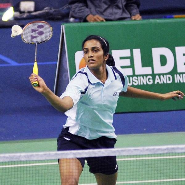 India's rising shuttler PV Sindhu settled for a bronze medal at the World Championships after suffering a straight-game defeat against world number three Ratchanok Inthanon in the semifinals of the prestigious event on Saturday.