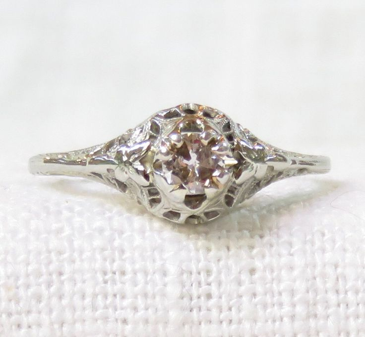 Vintage 18k Gold Diamond Enagement Ring .25 Carat by MagpieVintageJewelry on Etsy https://www.etsy.com/listing/230358621/vintage-18k-gold-diamond-enagement-ring