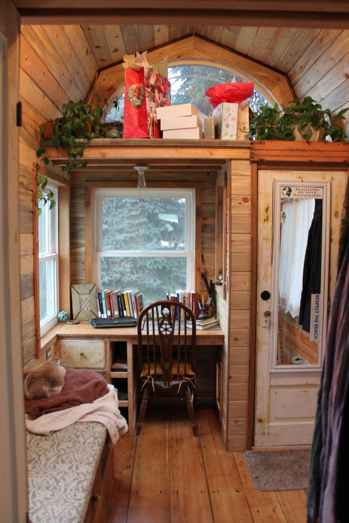 I don't normally like gambrel roofs from the outside, but the big window makes this one more attractive.  I love the headspace from the inside, and love that desk.  Also, I believe it is made from salvaged materials.  April's tiny house...130 square foot tiny house on wheels
