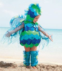 baby glitterfish costume    Your little minnow might be happy as a clam in this costume. Our gently rounded bodysuit features iridescent scalloped scales, wispy tulle and lots of sequins. Comes with a soft matching hood and lamé leg warmers. Go fish (for candy)! 4-piece set. Polyester, nylon. Imported.  #35181  $48.00