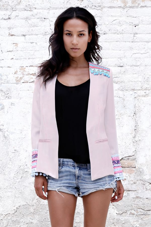 This loosely tailored collarless blazer will quickly become a go-to piece in your wardrobe. This mid-weight style has a touch of stretch for a confortable and fluid fit. Colored shoulder and cuffs embroidery.Embellished cuffs and shoulders Without flap Basic shoulder pads Jetted pockets Fully lined 100% Polyester Dry clean Made in Barcelona