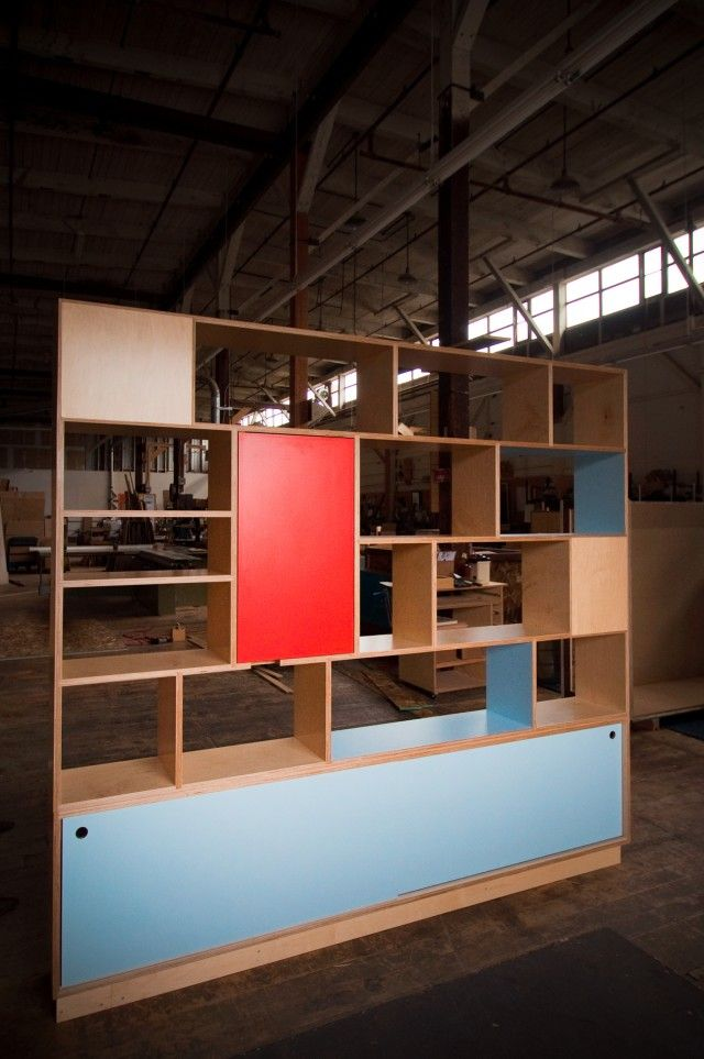 Entry bookcase that also serves as a room divider by Kerf Design.