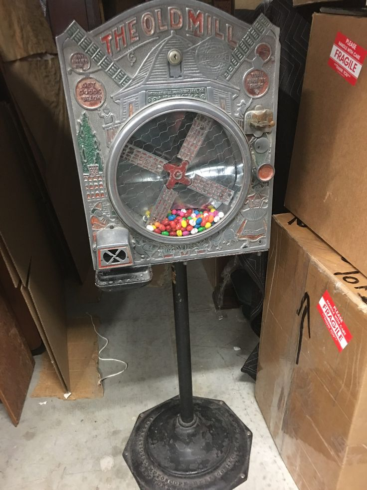 Old Mill Wind Mill Gum Candy Vendor Machine by Mutoscope Reel Co., 1920's Old Mill Wind Mill Gum Candy Vendor Machine Mfg. by International Mutoscope Reel Co. This floor model 1920's gumball vending machine by In..., https://www.gameroomshow.com/product/vintage-vending-machines/old-mill-wind-mill-gum-candy-vendor-machine-mutoscope-reel-co/, ,