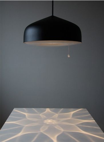Illusia by Finnish glass designer Kirsti Taivola, is a lamp with hand blown glass balls hidden inside that cast this beautiful blooming pattern when light is on.