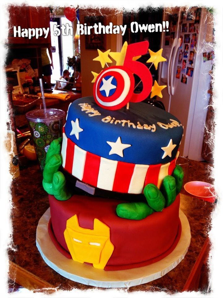 super hero cake with avengers hulk hands holding captain america owen