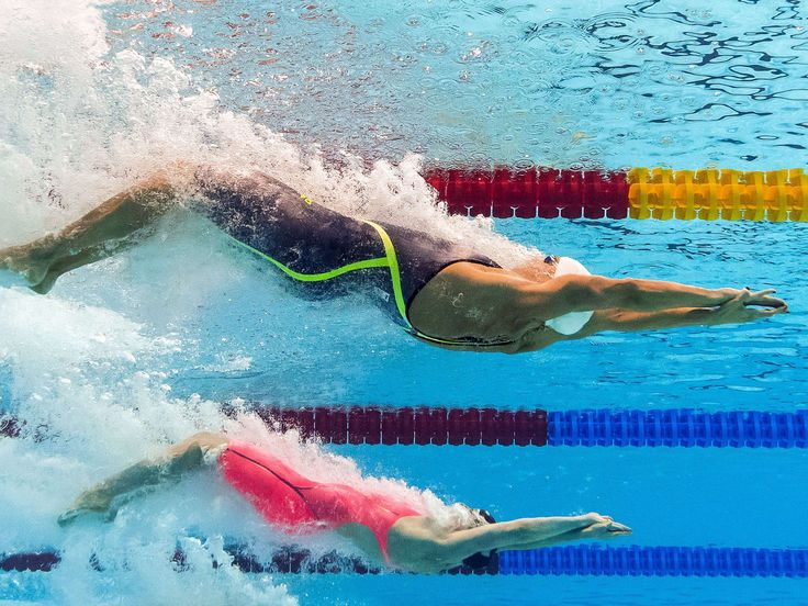 The USA's Missy Franklin, top, and Hungary's Katinka Hosszu compete in the final of the women's 200m backstroke swimming event at the 2015 FINA World Championships in Kazan.  AFP/Getty Images