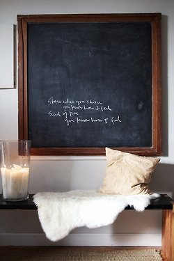 cozy candle lit entry chalkboard wall
