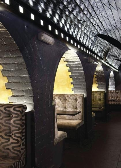 Intimate booths have been created from stark vaults in this former Victorian bank building