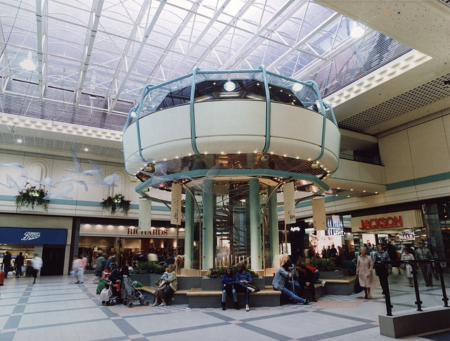 Eldon Square Shopping Centre Newcastle upon Tyne City Engineers 1991.  At the time it was built it was the largest indoor mall.  John Lewis coffee shop was in the space age looking donut.  I used to meet my best friend here on Thursday night late night shopping :)