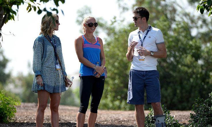 Caroline Wozniacki, wearing a Flex Loop, watches Rory McIlroy in Dubai along side Manchester United's Michael Carrick
