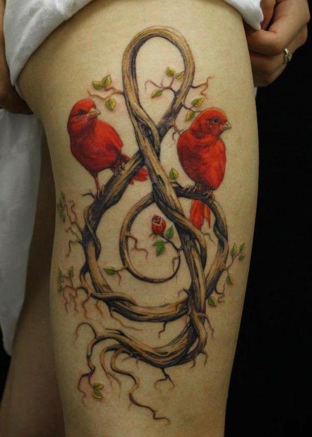 Tattoo rote Vögel Noten Ast