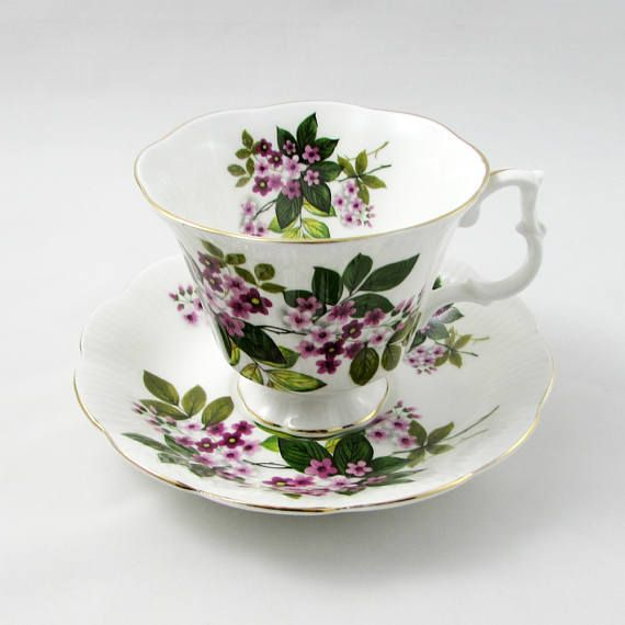 Beautiful bone china tea cup and saucer set made by Royal Albert. Tea cup and saucer have small purple flowers all over. Gold trimming on cup and saucer edges. Excellent condition (see photos). The markings read: Royal Albert Bone China England Please bear in mind that these are