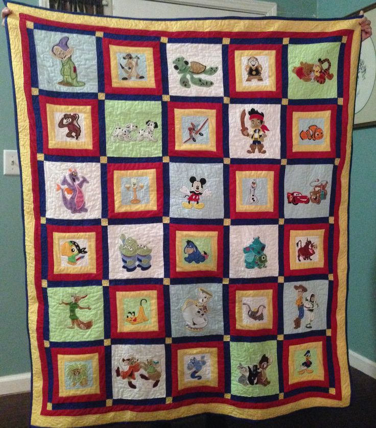 Disney quilt I made using applique patterns that I downloaded to my Brother embroidery machine.