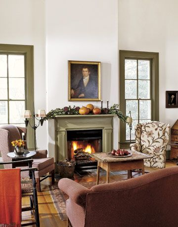"""A fireplace warms the space where a potbellied stove once stood in this Colonial living room. The green hue around the windows and mantel was inspired by trips to Williamsburg, Va.""  Photo credit: Keith Scott Morton."