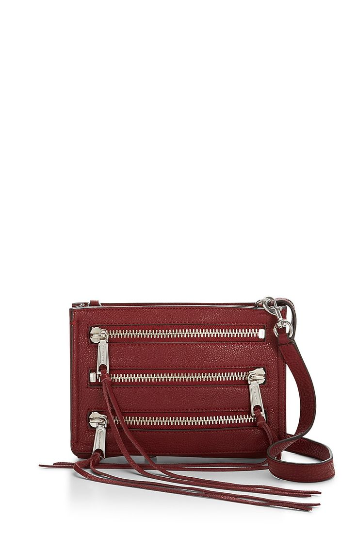 Moto 3 Zip Crossbody - Unzipping is sexy. Now you get extra practice. This little moto-inspired leather crossbody is perfect for day trips or nights out, fitting just the essentials. Long swishy fringe adds a little drama.