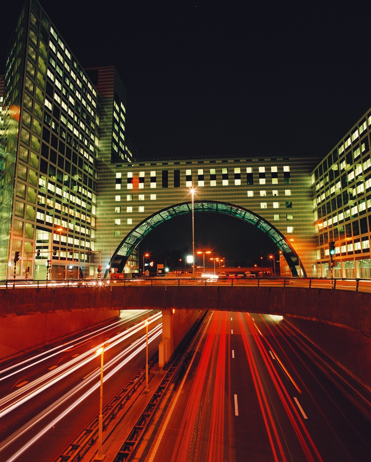Traffic passing by The Hague's modern architecture at night; The Hague, Netherlands  (Photo courtesy: Den Haag Marketing)