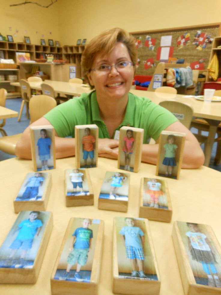 use photos of the actual children in the classroom attached to wooden blocks. These blocks can be used by the children to play, pretend, anddevelop language skills throughout their learning centers. These 'block people' give the children relative people to play with rather than plastic, painted figures that could be store bought.