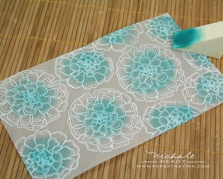 Emboss flowers with white embossing powder. Ink center of flowers. Turn vellum over and attach to cardstock.