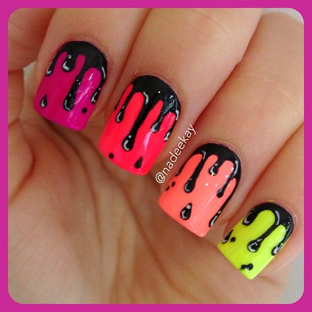 Shiny black drips on bright neon bases.