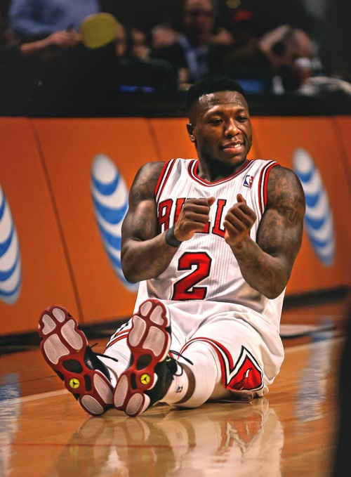 nate robinson excited. looks like he was dancing on the floor. what a freak! hahahaha